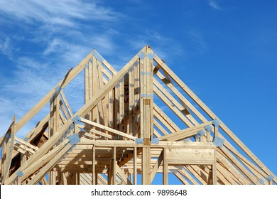 Wooden rafters of a new home under construction.