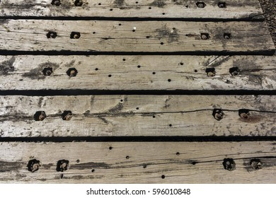 Wooden railway sleepers used as a jetty.