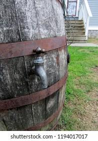 Wooden rain barrel with brass spigot