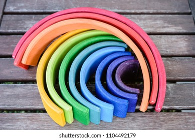 Wooden rainbow toy with many colors for children learning