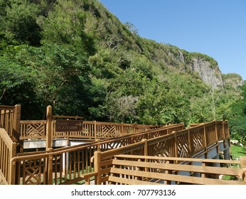 Wooden ramps at the Kalabera Cave in Saipan, Northern Mariana Islands, with the Suicide Cliff in the background