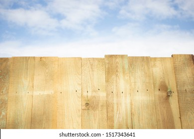 wooden raw boards against a blue sky