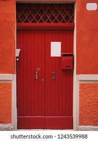 Wooden red door.
