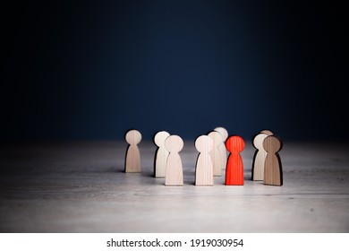 The wooden red figure of a man stands out from the crowd.