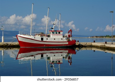 Wooden red fisherman boat in harbor