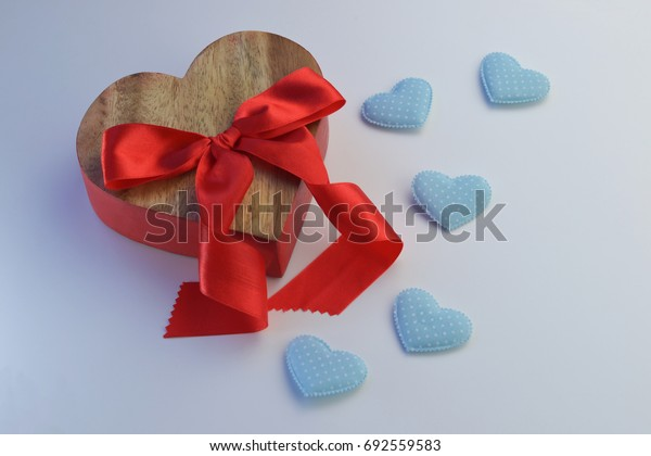 Wooden red heart With a red bow