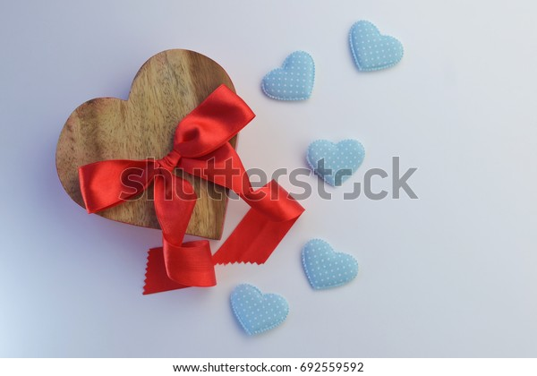 Wooden red heart on valentine's day And five blue hearts