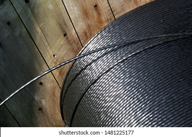 wooden reel with fiber cable in sunshine at construction site