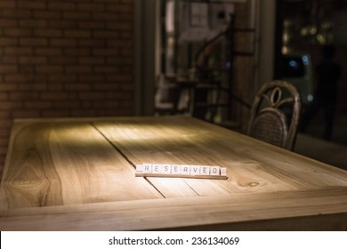 wooden reserved sign in restaurant