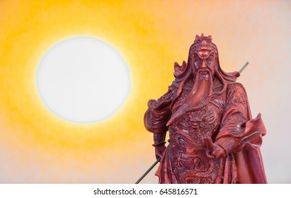 wooden resin statue of Guan Yu with sunset background, Chinese legend god