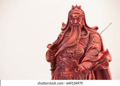 wooden resin statue of Guan Yu on whith background, Chinese legend god