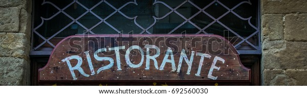 wooden restaurant sign italy