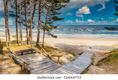 Wooden resting spot and footpath leading to a shore of the Baltic Sea, Jurmala, Latvia