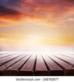 wooden retro deck and sunrise or sunset sky/ Summer holidays background