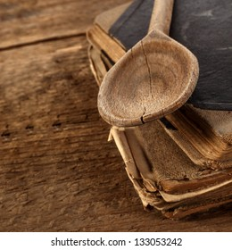 wooden retro spoon and book