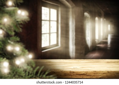Wooden retro table with christmas tree and with window of sun light