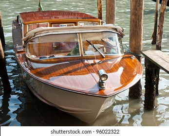 wooden riva boat parked on the canal in Venice