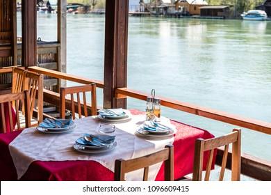 Wooden riverside restaurant on the riverbank of the Ada Bojana river near Ulcinj, specialising in excellent fresh fish soup, Montenegro