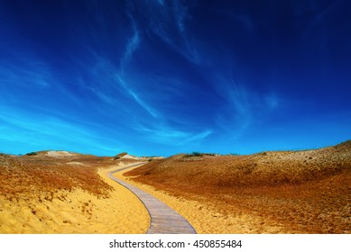 Wooden road in the sand dunes.