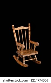 wooden rocking chair isolated on black background
