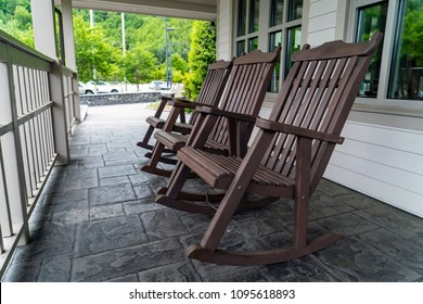 Wooden Rocking Chairs On Patio