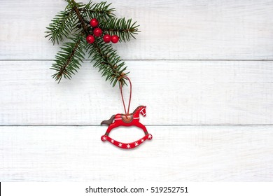 Wooden rocking horse over wooden background, Christmas decoration