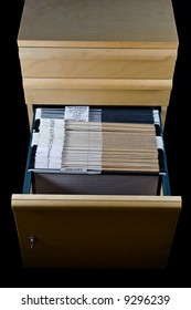 Wooden rolling file cabinet with a drawer opened, showing 43 hanging folders.