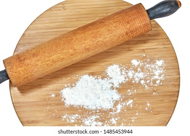 A wooden rolling pin on a bamboo cutting board isolated on white