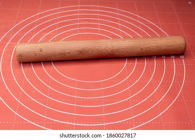 Wooden rolling pin on silicon board