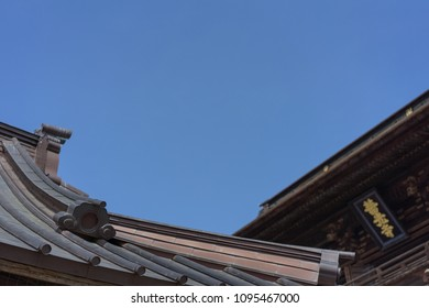 Wooden roof of temple in japan.Japanese word is name of temple Call Zenkoji temple.