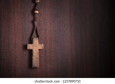 wooden rosary cross, for religious,themes with copyspace
