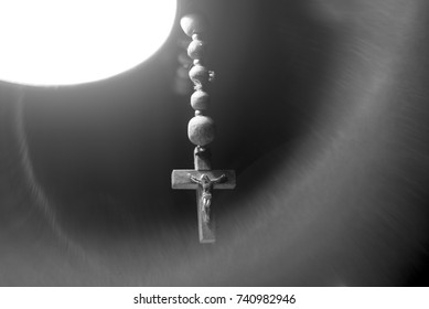 The wooden rosary in the light black and white image
