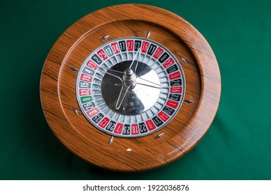 Wooden roulette isolated on green background