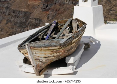 A wooden row boat sitting on a roof top in the village of Fira on the island of Santorini in Greece.