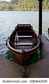 Wooden rowboat moored at lake Bled, Slovenia