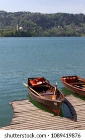 Wooden rowboats moored at lake Bled, Slovenia