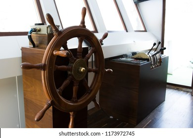 Wooden rudder and navigational equipment inside the captain's cabin
