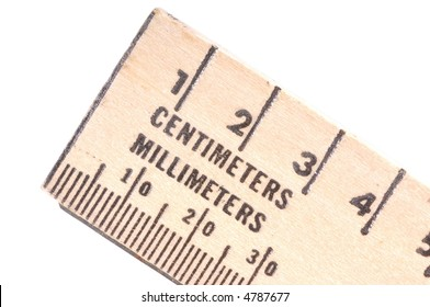 Wooden ruler with centimeters and millimeters.