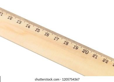 Wooden ruler macro shot isolated on white background