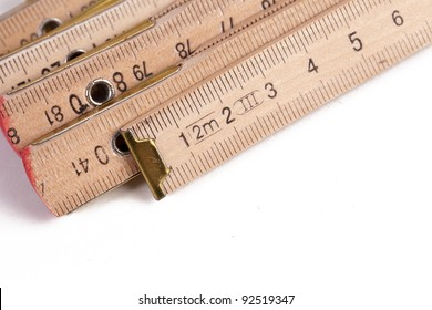 A wooden ruler on a white background
