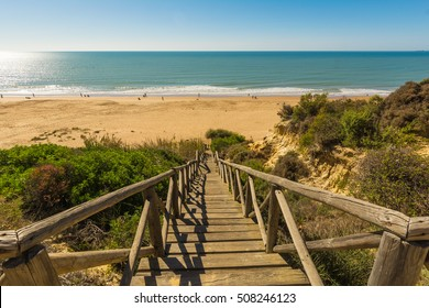 Wooden runway within Mazagon beach, Huelva, Spain