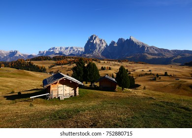Wooden rural farmer's shed in Seiser Alm meadow in the Dolomites, North Italy, Sudtirol (Trentino / Alto Adige). Scenic autumn view of a big valley in the Alps Mountains
