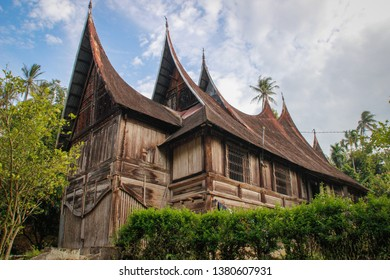 Wooden rural house with an unusual roof in the village of the Minangkabau people on the island of Sumatra, Indonesia.
