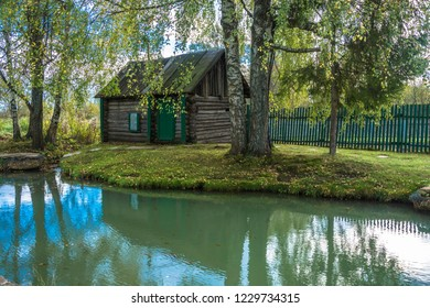 Wooden Russian bath on the shore of a small pond in the village of Vyatka, Yaroslavl region, Russia.