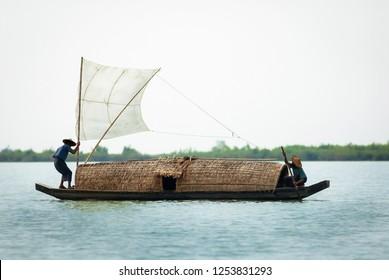 Wooden sail boat of indigenous on Kaladan River, Sittwe district, Rakhine State, Myanmar.