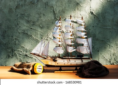 wooden sail ship toy model with torch on the table