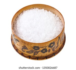 wooden salt cellar with coarse grained Sea Salt isolated on white background