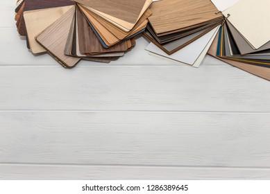 Wooden sampler in fan on light background