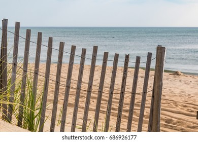 A wooden sand fence with an ocean background in Nags Head, North Carolina.