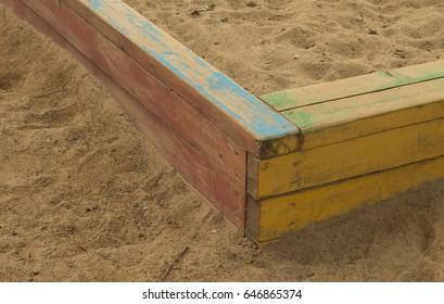 Wooden sandbox on the children's playground